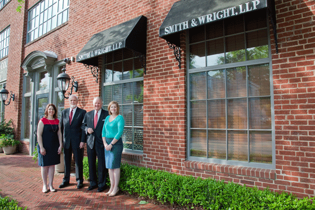 Staff of Smith & Wright outside office.